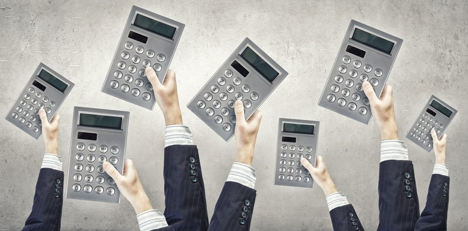 hands holding calculators
